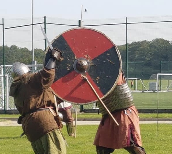 Reenactors at an Odin's Aett viking day in Peterborough 2019.  During this combat an axe became firmly embedded in a shield.